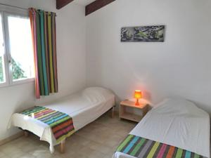 Hebergement Holiday Home Les Aloes : photos des chambres