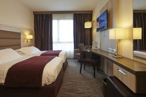 Kyriad Prestige Lyon Est - Saint Priest Eurexpo Hotel and SPA : photos des chambres