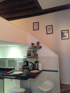 Appartement Cosy apartment Marais Rosiers : Appartement