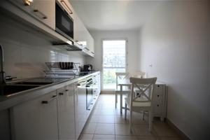 Appartement Friendly Rentals La Defense U Arena : photos des chambres