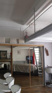 Appartement coquet studio en mezzanine : photos des chambres