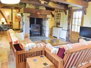 Hebergement Holiday Home Vimoutiers with Fireplace VIII : photos des chambres