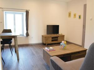 Appartement One-Bedroom Apartment in Sainteny : photos des chambres