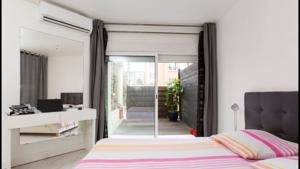 Appartement cosy F2 terrasse & parking : photos des chambres