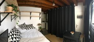 Appartement Le studio du Moulin : photos des chambres