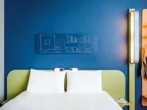 Hotel ibis budget Saint Quentin Yvelines - Velodrome : photos des chambres