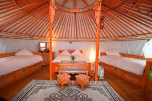 Hebergement Yourte Nomade-Lodge : photos des chambres