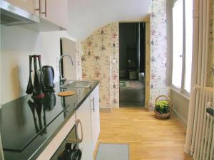 Appartement One-Bedroom Apartment in Ocquerre : photos des chambres