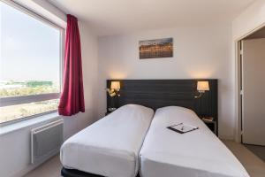 Hebergement Zenitude Hotel-Residences Toulouse Fluvia : photos des chambres